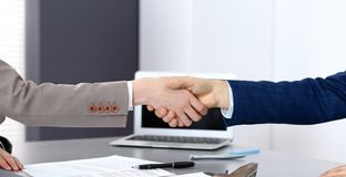 Business people shaking hands, finishing up a meeting. Papers signing, agreement and lawyer consulting concept.  Royalty Free Stock Image