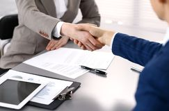 Business people shaking hands, finishing up a meeting. Papers signing, agreement and lawyer consulting concept.  Stock Images