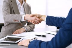 Business people shaking hands, finishing up a meeting. Papers signing, agreement and lawyer consulting concept.  Royalty Free Stock Photography