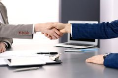 Business people shaking hands, finishing up a meeting. Papers signing, agreement and lawyer consulting concept.  Stock Photography