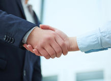 Business people shaking hands. Business people shaking hands, finishing up a meeting. Partners made deal and sealed it with handclasp. Formal greeting gesture Stock Photography