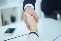 Business people shaking hands, finishing up a meeting. Partners made deal and sealed it with handclasp. Formal greeting gesture Royalty Free Stock Photo