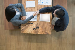 Business people shaking hands after finishing up a meeting. Two Royalty Free Stock Photo