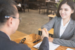 Business people shaking hands after finishing up a meeting. Two Royalty Free Stock Image
