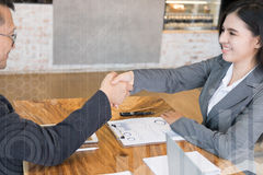 Business people shaking hands after finishing up a meeting. Two Stock Photography