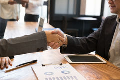 Business people shaking hands after finishing up a meeting. Two Stock Photo