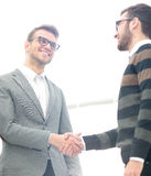 Business people shaking hands, finishing up a meeting Stock Image