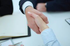 Business people shaking hands, finishing up a meeting. Welcoming friend, introduction or thanks gesture Royalty Free Stock Image