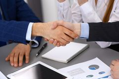 Business people shaking hands, finishing up a papers signing. Meeting, agreement and lawyer consulting concept.  Stock Image