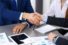 Business people shaking hands, finishing up a papers signing. Meeting, agreement and lawyer consulting concept.  Stock Photography
