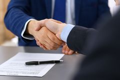Business people shaking hands, finishing up a papers signing. Meeting, contract and lawyer consulting concept.  Royalty Free Stock Photography