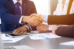 Business people shaking hands, finishing up a papers signing. Meeting, contract and lawyer consulting concept.  Stock Photos
