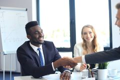 Business people shaking hands during a meeting. stock photo