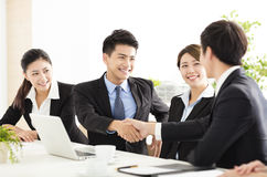 Business people shaking hands during meeting. Asian business people shaking hands during meeting Stock Photos