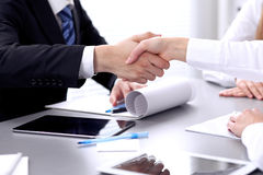 Business people shaking hands at meeting. Clouse up of handshake.  stock photos