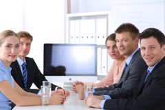Business people shaking hands after meeting in office. Royalty Free Stock Images