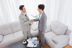 Business people shaking hands after meeting Stock Images