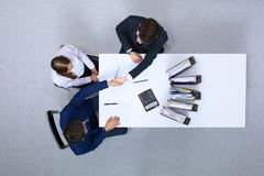 Business people shaking hands at meeting, view from above. Bookkeeper or financial inspector making report, calculatin. G or checking balance. Internal Revenue stock images