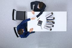 Business people shaking hands at meeting, view from above. Bookkeeper or financial inspector making report, calculatin. G or checking balance. Internal Revenue stock photography