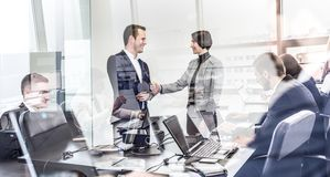 Business people shaking hands in moder corporate office. stock images