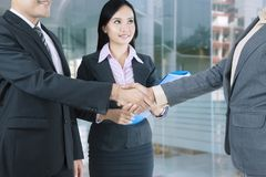 Business people shaking hands after negotiation royalty free stock photo