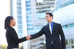 Business People Shaking Hands at Office Stock Photography