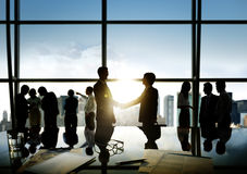 Business People Shaking Hands in the Office Stock Photos