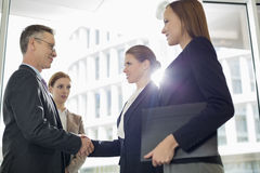 Business people shaking hands in office Royalty Free Stock Images