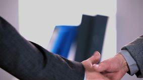 Business people shaking hands. In the office stock video