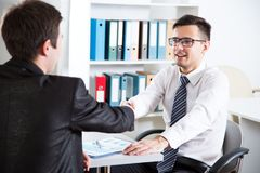 Business handshake. Business people shaking hands in an office Stock Photos