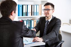 Business people shaking hands. In an office Stock Photos