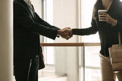 Business people shaking hands in office Royalty Free Stock Photo
