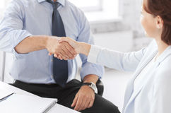 Business people shaking hands in office Royalty Free Stock Image