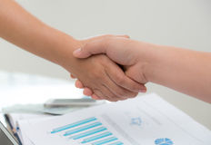 Business people shaking hands over business Stock Photos