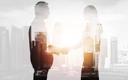 Business people shaking hands over city background Royalty Free Stock Photo