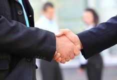 Business people shaking hands over a deal. Closeup of business people shaking hands over a deal Royalty Free Stock Photos