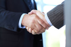 Business people shaking hands over a deal Royalty Free Stock Image
