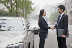 Business People Shaking Hands On Road Royalty Free Stock Photos