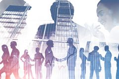 Business people shaking hands, skyscrapers, graphs royalty free stock images