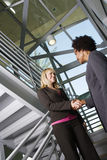 Business People Shaking Hands On Staircase Stock Image