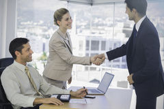 Business people shaking hands with their future patner Royalty Free Stock Images