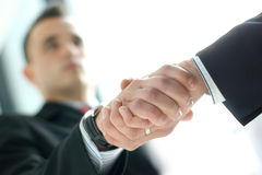 Business people shaking hands together. Business people are shaking hands together in order to show success. Image taken on an abstract background Royalty Free Stock Photo