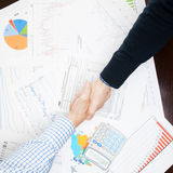 Business people shaking hands - view from top - 1 to 1 ratio Stock Photography