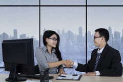 Business people shaking hands in winter background Stock Photography