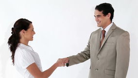 Business people shaking their hands. Against a white background stock video footage