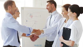 Business people shaking their hands Stock Images