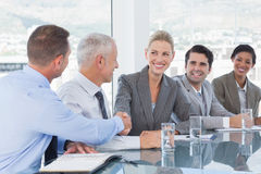 Business people shaking their hands Royalty Free Stock Photos
