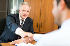 Business people shaking their hands Stock Photography