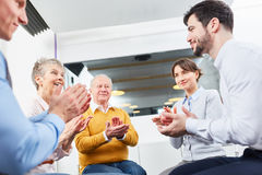 Business people share applause in workshop Stock Images