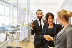 Business people sharing handshake in office royalty free stock images